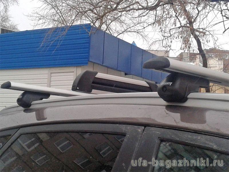 Багажник на крышу Kia Sportage III (SL), Атлант, крыловидные аэродуги