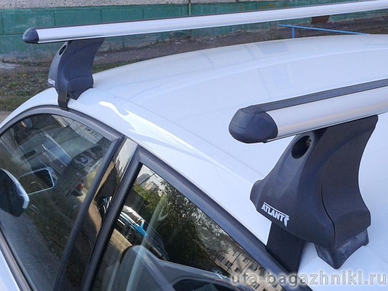 Багажник на крышу Volkswagen Polo sedan, Атлант: аэродинамические дуги и опоры типа Е